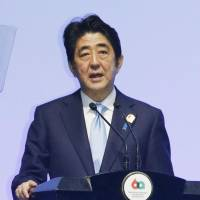 Prime Minister Shinzo Abe speaks Wednesday at the Asia-Africa Summit in Jakarta, where he expressed 'heartfelt gratitude' to 'friends' who aided Japan's postwar reintegration. | KYODO