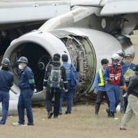 Investigators examine on Wednesday the  Asiana Airlines aircraft from Seoul that ran off the runway at Hiroshima Airport the previous night. Police said they are investigating the accident site as a crime scene, potentially involving corporate negligence resulting in injury. | KYODO