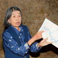 Fumiko Nashiro, a survivor of the Battle of Okinawa in 1945, speaks last November about her wartime experience in a bunker where she retreated amid the fighting in Itoman, Okinawa.   KYODO