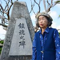 Fumiko Nashiro, a survivor of the 1945 Battle of Okinawa, speaks last November about her wartime experience, in front of a monument dedicated to the war dead in Itoman, Okinawa Prefecture. | KYODO