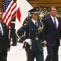 Defense Minister Gen Nakatani and U.S. Secretary of Defense Ash Carter inspect an honor guard at the Defense Ministry in Tokyo on Wednesday. | REUTERS