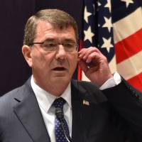 U.S. Defense Secretary Ash Carter answers questions during a joint news conference with Defense Minister Gen Nakatani in Tokyo on Wednesday. | AFP-JIJI