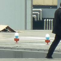 A drone that landed on the roof of the prime minister's office lies covered by a piece of cardboard on Wednesday. | KYODO