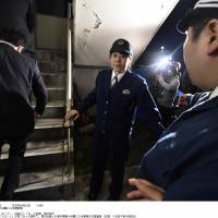 Metropolitan Police Department investigators arrive at Obama Police Station in Fukui Prefecture on Saturday after a man turned himself in over the landing of a drone on the roof of the prime minister's office last week.   KYODO