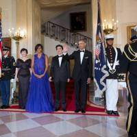 President Barack Obama and first lady Michelle Obama with Prime Minister Shinzo Abe and his wife Akie Abe, pose for the Official Photo at the Grand Staircase before the start of the State Dinner at the White House on Tuesday. In earlier welcoming the Abes, Obama noted karaoke and anime are among things Japanese that Americans are thankful for. | AP