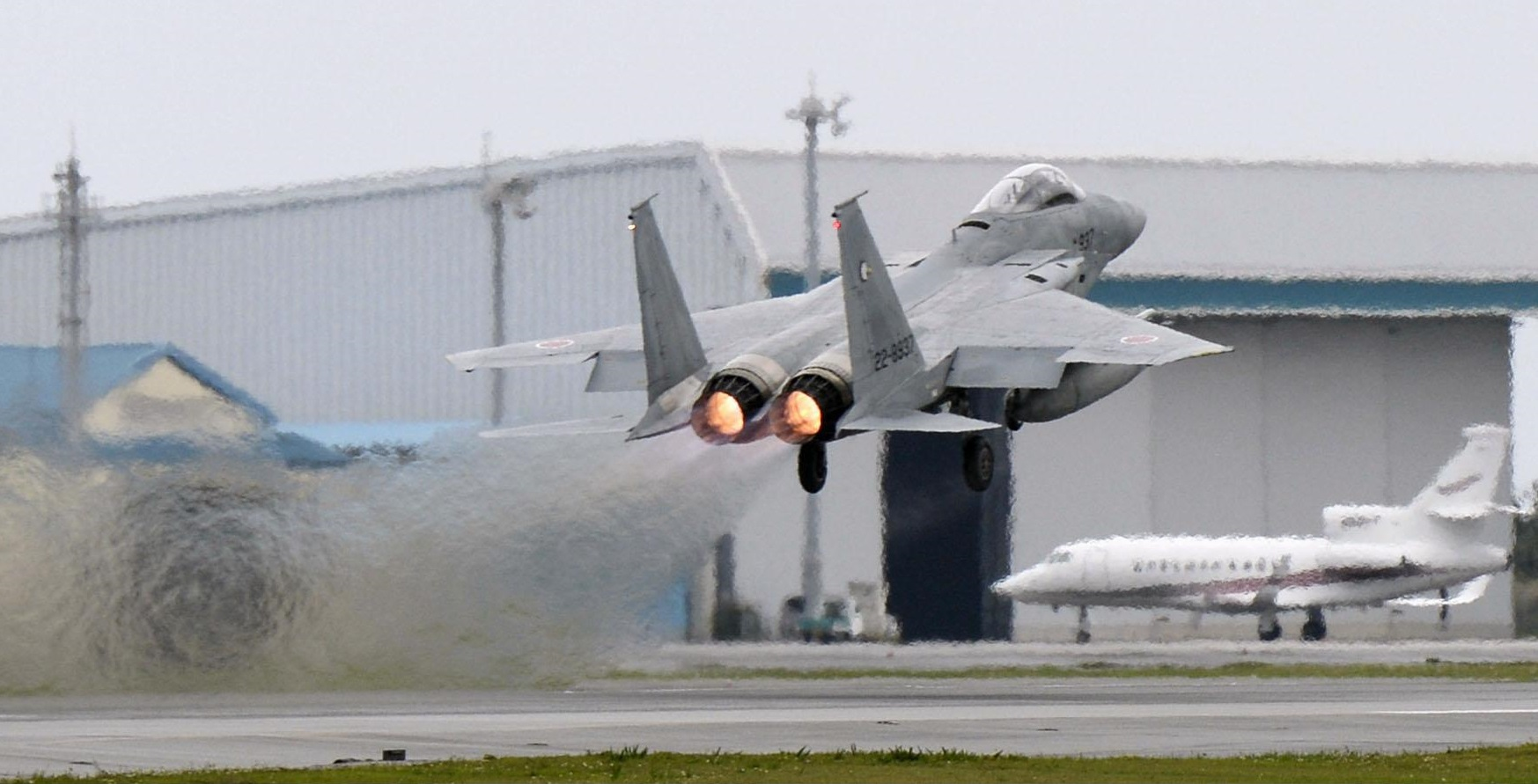An F-15 fighter takes off on an intercept mission from the Air Self-Defense Force's Naha base in Okinawa, interrupting a training session that was open to the media. | KYODO
