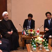 Iranian President Hassan Rouhani and Prime Minister Shinzo Abe hold a bilateral meeting on the sidelines of the Asian Africa Conference in Jakarta on Wednesday. | ROMEO GACAD / POOL / AFP-JIJI