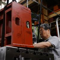Loyalty to 1960s machine shows risk from Japan's aging factories
