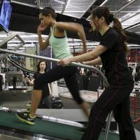Miss Universe Japan Ariana Miyamoto (center) works out in a gym in Tokyo on Wednesday. | REUTERS