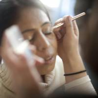 For the first time in her life, a Nepalese woman has makeup applied to her face during a Coffret Project workshop organized by Mai Mukaida in Katmandu in 2010. | COURTESY OF MAI MUKAIDA
