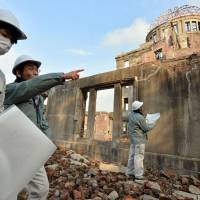 The Hiroshima A-Bomb Dome is surveyed in March last year. Experts from the U.S. and Japan are exploring ways to disclose key online hibakusha archival collections.   KYODO