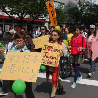 Visa overstayers march for right to remain in Japan