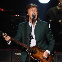 Paul McCartney performs at Nippon Budokan Hall in Tokyo on Tuesday night. The concert marked McCartney's first return to the venue since the Beatles played there in 1966. | KYODO