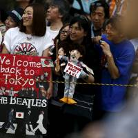 Fans await Paul McCartney's arrival at the Nippon Budokan Hall in Tokyo on Wednesday. | REUTERS