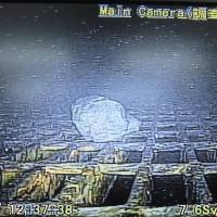 A rock is shown inside the primary containment vessel of the No. 1 reactor at the Fukushima No. 1 nuclear plant in this image taken by a robot. How the rock got there is not yet known, but the robot lasted less than three hours in the deadly radioactive chamber. | TOKYO ELECTRIC POWER CO./KYODO