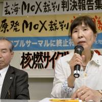 Hatsumi Ishimaru (right), who heads a group of plaintiffs in a lawsuit to stop the Genkai nuclear plant's reactors from burning MOX 'pluthermal' fuel, speaks to reporters after the suit was tossed out March 20. The plaintiffs are planning an appeal. | KYODO