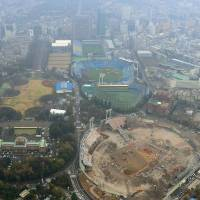 An aerial photo taken Wednesday of Prince Chichibu Memorial Rugby Ground (top) and Jingu Stadium (second from top), which will be rebuilt by 2025. | KYODO