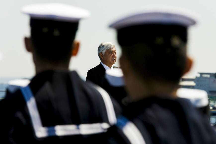 Abe breaking arms taboo with Japan's first defense trade show