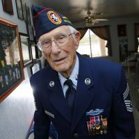 Retired Chief Master Sgt. Harold Bergbower, 94, who was in the U.S. Army Air Corps and then the air force, pauses in front of his military medals in Phoenix on April 21, while talking about spending nearly four years in various Japanese POW camps. He says he still has nightmares about his treatment almost 70 years after World War II ended. | AP