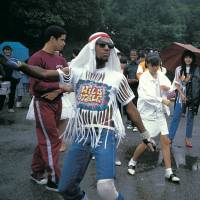 Singing in the rain: Hip-hop emcee Busy Bee begins dancing in the rain in Tokyo's Yoyogi Park surrounded by rockers and other local dancing groups that frequented the park in the 1980s. | CHARLIE AHEARN