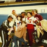 Bullet to Tokyo: The stars of 'Wild Style' — including graffiti writers Lady Pink and Lee George Quinones — stand in front of a bullet train in Tokyo. Promotional tour manager, and the man who brough 'Wild Style' to Japan, Kaz Kozui, stands in front of the team. | CHARLIE AHEARN