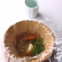 On the table at Dining Out: Turtle soup and organic vegetables from Kitayama-en farm are served in a unique wooden bowl carved by a local craftsperson.