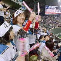 No easy answers: Fans cheer during the Fighters' opening-night matchup against the Tohoku Rakuten Golden Eagles on March 27 at Sapporo Dome. | KYODO
