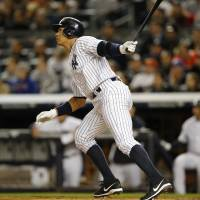 See you later: Alex Rodriguez hits a solo homer during the first inning of the Yankees' win over the Mets on Sunday. | AP