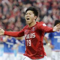 Gamba, Reds force way to top again