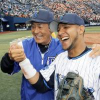 Happier times: Yulieski Gourriel, who was released by the Yokohama BayStars on Thursday, smiles with manager Kiyoshi Nakahata after his first game with the club last summer. | KYODO