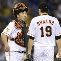 Who you gonna call: Shinnosuke Abe (left) was a steadying presence for the Giants this past weekend. | KYODO