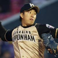 Another bump in the road: Fighters pitcher Yuki Saito allowed four runs against the Eagles on April 17 in Sendai.   KYODO