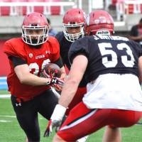 RB Gray blazing trail for Japanese football with Utes