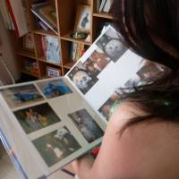 Lost: A Japanese mother who lost a child through abduction looks through a family photo album. | KYODO
