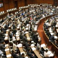 The Upper House votes to join the 1980 Hague Convention on international child abduction in May 2013. | KYODO