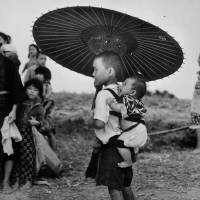 Children stand on the road during the Battle of Okinawa. | WIKIMEDIA COMMONS/NATIONAL ARCHIVES AND RECORD