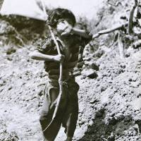 Tomiko Higa holds a white flag on the Okinawan mainland on 25 June, 1945. | WIKIMEDIA COMMONS/NATIONAL ARCHIVES AND RECORD