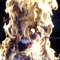 Skipjack tuna is seared in the flames after being sliced into chunks at Tosa Tataki Dojo. | MANDY BARTOK