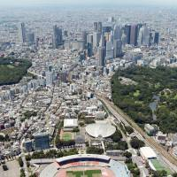 In the works: The National Stadium was one of many buildings torn down ahead of the 2020 Olympics. Other changes are afoot as Tokyo seeks to fall in line with standards set by the International Olympic Committee. | KYODO