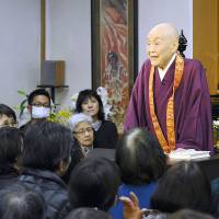 Preaching to the choir: Buddhist nun Jakucho Setouchi gives a lecture to a crowd in Kyoto.   KYODO