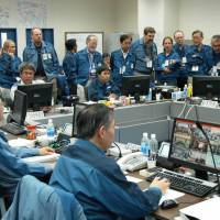 Members of the IAEA fact-finding team in Japan examine the technical support center of the Fukushima Daini Nuclear Power Plant on May 26, 2011. | IAEA