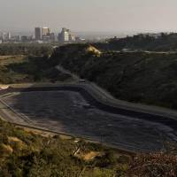 Danger zone: An empty water reservoir sits in the hills above Los Angeles on April 5 as a severe drought continues to affect the state of California. | AFP-JIJI