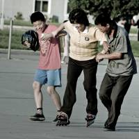 Staying in control: A woman learns to in-line skate with the assistance of her family in Pyongyang, North Korea. | MATT PAISH/CC BY 2.0
