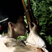 Sound travels: A still from the documentary film 'KanZeOn,' directed by Neil Cantwell and Tim Grabham, shows Eri Fujii playing a Japanese reed instrument called the shō .