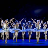 Floating free: Artists of the Birmingham Royal Ballet dance as stars during David Bintley's original 'Cinderella.' | ARTISTS OF BIRMINGHAM ROYAL BALLET AS STARS; PHOTO: BILL COOPER