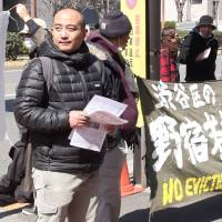 Munenori Yamakawa (on left) and other opponents of the redevelopment plan have accused the ward of disregarding the plight of the homeless that use the park and of ignoring dissenting voices. | MICHAEL PENN