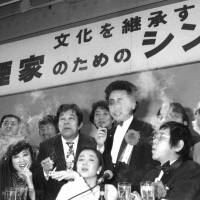 Puff peace: Two hundred smokers, including celebrities, gather to defend smokers' rights at a 'Symposium on Behalf of Heavy Smokers' held at a Tokyo hotel on April 1, 1985, the day that the Japan Tobacco and Salt Public Corp. monopoly became Japan Tobacco Inc. JT is a well-known post-retirement amakudari destination for Finance Ministry bureaucrats. | KYODO