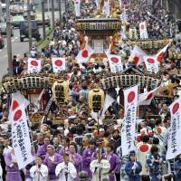 Faith-driven: It may help to abandon simple political theory in favor of the sociology of religion when trying to understand Japan. | AP