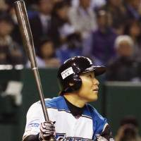 Key contributor: The Fighters' Kensuke Tanaka belts a two-run homer in the fifth inning against the Lions on Tuesday at Tokyo Dome. Hokkaido Nippon Ham defeated Seibu 4-0. | KYODO