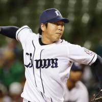 Game face: Lions starter Ken Togame fires a pitch during Tuesday's game against the Fighters. Togame worked seven innings of two-run ball and Seibu defeated Hokkaido Nippon Ham 6-2. | KYODO